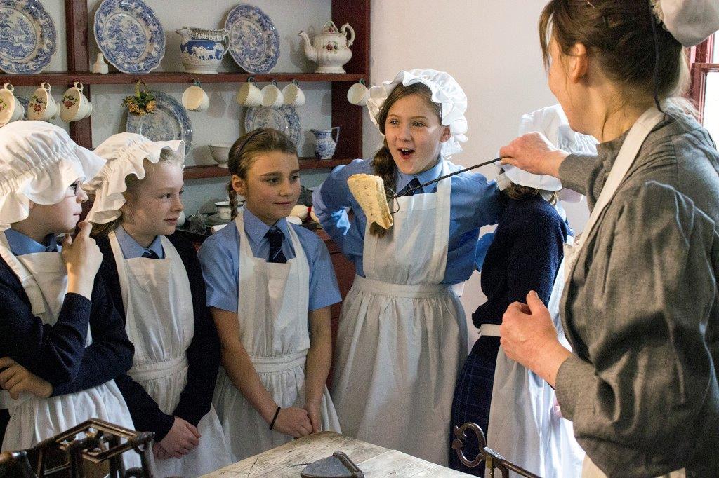 preparing toast in the Victorian kitchen